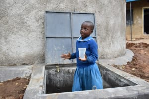 The Water Project: Lwombei Primary School -  Posing With Water