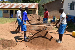 The Water Project: Lwombei Primary School -  Students Helping