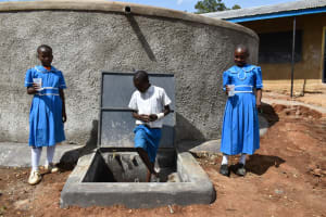 The Water Project: Lwombei Primary School -  Students At The Water Tank