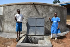 The Water Project: Lwombei Primary School -  Students Posing At The Tank