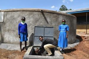 The Water Project: Lwombei Primary School -  Teacher Enjoying Water