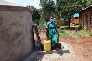 The Water Project: KG Jeptorol Primary School -  Students Carry Water