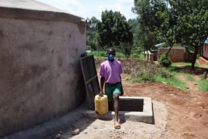 The Water Project: KG Jeptorol Primary School -  Students Carrying Water