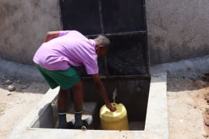 The Water Project: KG Jeptorol Primary School -  Students Fetching Water