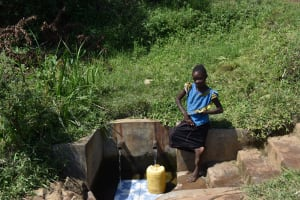 The Water Project: Mahira Community, Jairus Mwera Spring -  Branice K Fetching Water