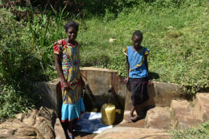 The Water Project: Mahira Community, Jairus Mwera Spring -  Carolyne And Branice At The Spring