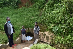 The Water Project: Mahira Community, Wora Spring -  Mary Afandi Brian And Roselyne Atema At The Spring