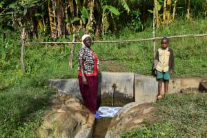 The Water Project: Mahira Community, Litinyi Spring -  Agnes Kutondo And Fernando At The Spring