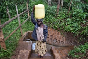 The Water Project: Harambee Community, Elijah Kwalanda Spring -  Leaving With Water From The Spring