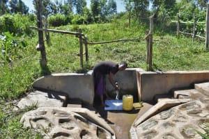 The Water Project: Mukhonje Community, Mausi Spring -  Grace M Fetching Water
