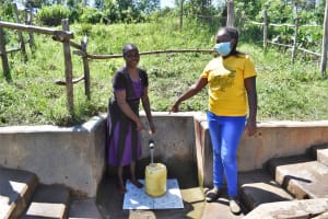 The Water Project: Mukhonje Community, Mausi Spring -  Grace And Nelly At The Spring