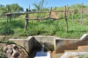 The Water Project: Mukhuyu Community, Chisombe Spring -  Water Flowing