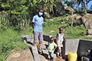 The Water Project: Mahira Community, Kusimba Spring -  Field Officer Ian With Valarie And Her Brother Lens