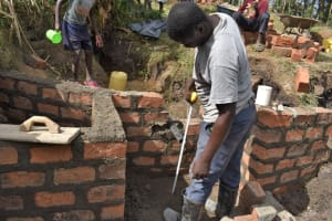 The Water Project: Malekha Central Community, Misiko Spring -  Setting The Pipe