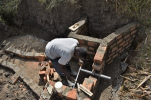 The Water Project: Malekha Central Community, Misiko Spring -  Aligning The Discharge Pipe