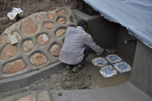 The Water Project: Malekha Central Community, Misiko Spring -  Installing The Tiles