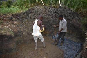The Water Project: Malekha Central Community, Misiko Spring -  Foundation Setting