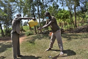The Water Project: Malekha Central Community, Misiko Spring -  Community Members Cleaning Their Hands