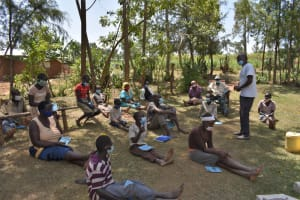 The Water Project: Malekha Central Community, Misiko Spring -  Community Members Listening To The Facilitator