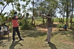 The Water Project: Malekha Central Community, Misiko Spring -  Demonstrating Contactless Greetings