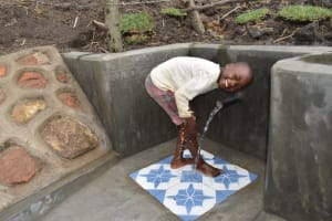 The Water Project: Malekha Central Community, Misiko Spring -  Elvis Enjoying The Water