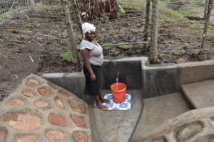The Water Project: Malekha Central Community, Misiko Spring -  Fetching Water From Misiko Spring