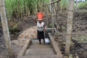 The Water Project: Malekha Central Community, Misiko Spring -  Leaving The Waterpoint With Water