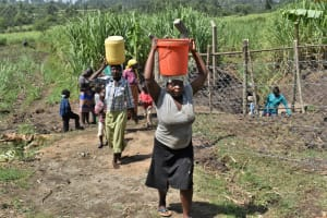 The Water Project: Malekha Central Community, Misiko Spring -  Leaving With Water From The Spring