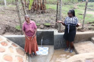The Water Project: Malekha Central Community, Misiko Spring -  A Light Moment Between A Community Member And Director Catherine Chepkemoi