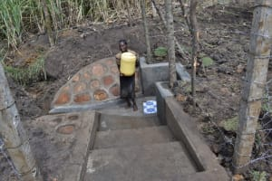 The Water Project: Malekha Central Community, Misiko Spring -  Lifting Her Full Jerrican