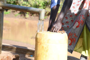 The Water Project: Mbitini Community A -  Container Fills At The Well