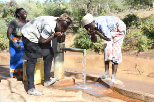 The Water Project: Mbitini Community A -  Drinking Water From The Well