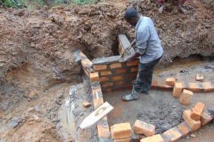 The Water Project: Makhwabuye Community, Majimazuri Lusala Spring -  Wing Wall Construction