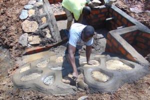 The Water Project: Makhwabuye Community, Majimazuri Lusala Spring -  Stone Pitching