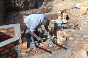 The Water Project: Makhwabuye Community, Majimazuri Lusala Spring -  Pipe Measurment And Setting