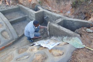 The Water Project: Makhwabuye Community, Majimazuri Lusala Spring -  Plastering