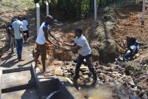 The Water Project: Makhwabuye Community, Majimazuri Lusala Spring -  Backfilling With Stones