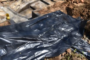 The Water Project: Makhwabuye Community, Majimazuri Lusala Spring -  Backfilling With Polythene Sheet