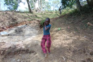 The Water Project: Makhwabuye Community, Majimazuri Lusala Spring -  A Boy Ferrrying Grass To Be Planted At The Spring Site