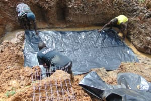 The Water Project: Makhwabuye Community, Majimazuri Lusala Spring -  Slab Setting
