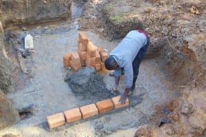 The Water Project: Makhwabuye Community, Majimazuri Lusala Spring -  Brick Setting