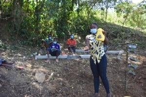 The Water Project: Makhwabuye Community, Majimazuri Lusala Spring -  Demostrating How To Use A Leaky Tin