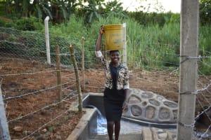 The Water Project: Makhwabuye Community, Majimazuri Lusala Spring -  Fetching Water Made Easier
