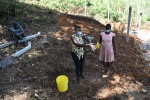 The Water Project: Makhwabuye Community, Majimazuri Lusala Spring -  Trainer Jemimah Leading A Handwashing Exercise