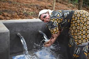 The Water Project: Makhwabuye Community, Majimazuri Lusala Spring -  Enjoying The Flowing Water