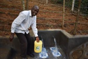 The Water Project: Makhwabuye Community, Majimazuri Lusala Spring -  People Fetching Water