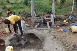 The Water Project: Indulusia Community, Wanyama Spring -  Community Member Helps Mix Plaster