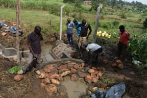 The Water Project: Indulusia Community, Wanyama Spring -  Backfilling Using Stones