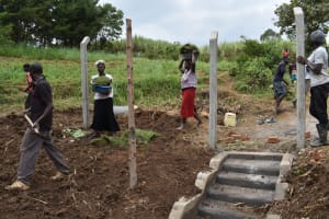 The Water Project: Indulusia Community, Wanyama Spring -  Community Members Carrying Grass For Planting