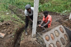 The Water Project: Indulusia Community, Wanyama Spring -  Setting Up The Fence